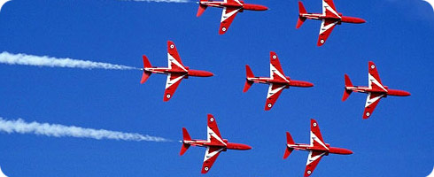 a photo of the Royal Airforce Red Arrows in formation flight